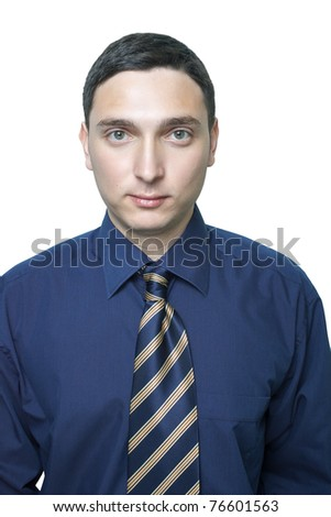 Serious young man in dark blue shirt and tie isolated on white - stock photo