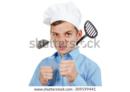 Serious young man in front of the competition for cooking. Humor in a chef's hat. Isolated on white - stock photo