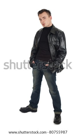 serious young man in leather jacket with hands in pocket - stock photo