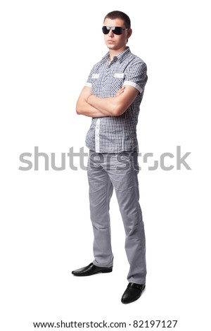 serious young man in sunglasses isolated on white background. Full length portrait - stock photo