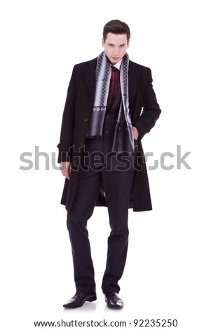 serious young man in winter or autumn clothes looking at the camera - stock photo