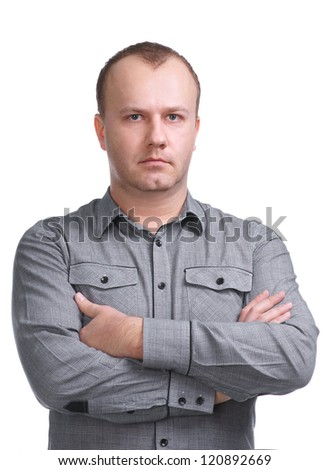 Serious young man looking at camera on a white background - stock photo