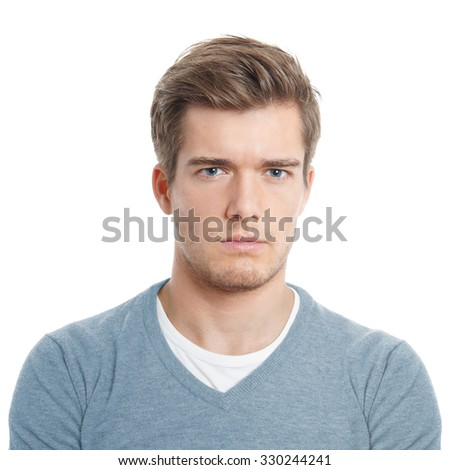 serious young man looking displeased or pissed off - stock photo