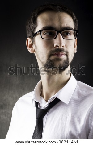 Serious young man portrait - stock photo