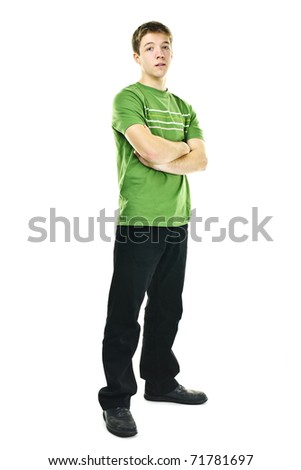 Serious young man standing full body with arms crossed isolated on white background