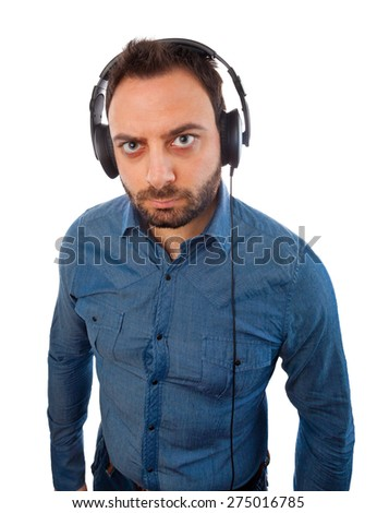 Serious young man with headphones on white background.