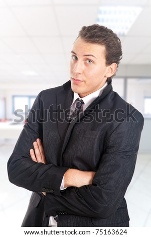 Serious young manager in his office - stock photo