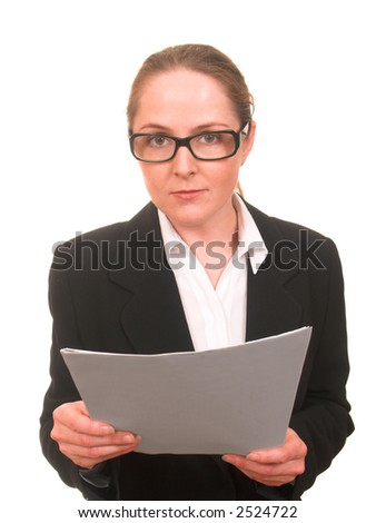 Serious young woman in business suit and glasses with papers in her hands looking to the camera isolated on white - stock photo