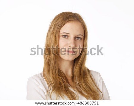Serious young woman portrait with brown hair.
