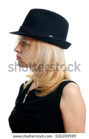 serious young woman with a black hat on a white background