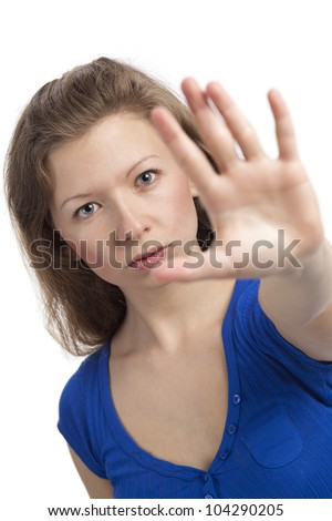 Serious young woman with hand raised to stop - stock photo