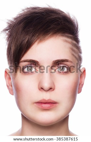 serious young woman with modern short hair - isolated - stock photo