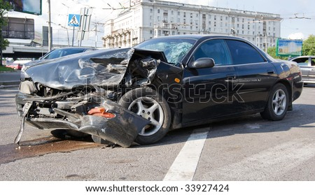 Seriously damaged business auto on the street - stock photo