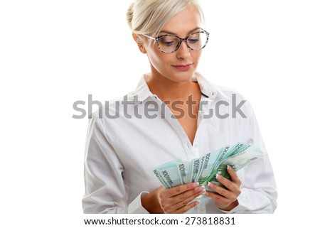 seriously young woman holding euro bills over white - stock photo