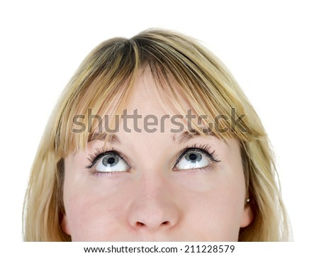 seriously young woman looking up - stock photo