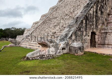 Serpent head stairway in El Castillo Pyramid, Chichen Itza, Mexico. - stock photo