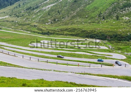 Serpentine in the Alps. Famous road to Spluga Pas between Italy and Switzerland - stock photo