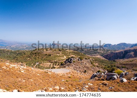 Serpentine road on island Crete, Greece, with olive trees plantations - stock photo