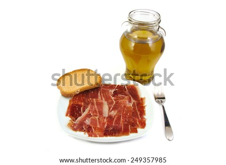 Serrano ham, bread and extra virgin olive oil. Jabugo. Mediterranean diet - stock photo