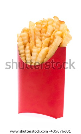 serrated French fries in a red paper bag isolated on a white background