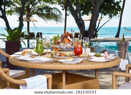 Served a table for lunch on the coast ocean - stock photo