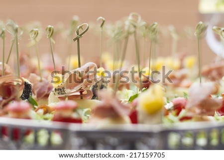 served banquet table, canapes - stock photo