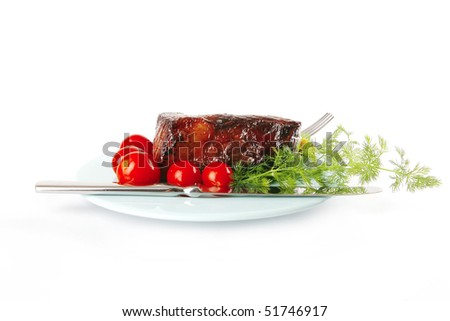 served beef meat chunk and tomatoes on blue - stock photo