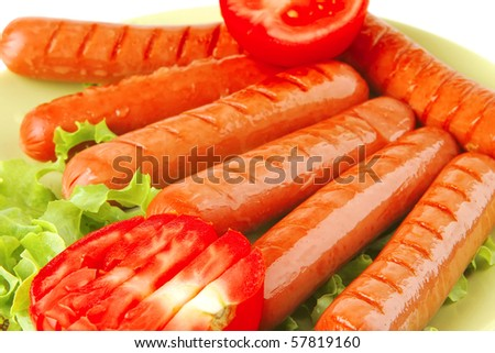 served beef roasted sausages on light dish - stock photo