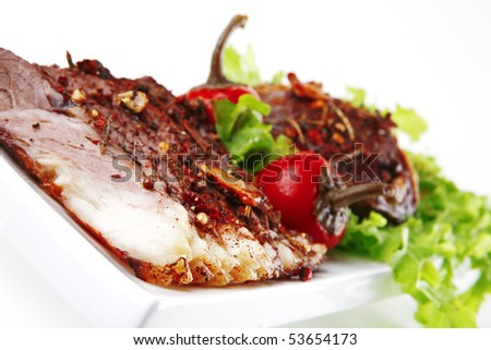 served beef steak on ceramic plate over white - stock photo