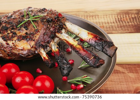 served charbroiled ribs on plate over wood - stock photo