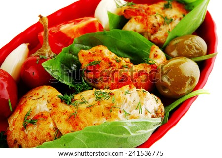 served chicken bbq on red plate with tomatoes and olives - stock photo