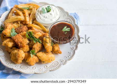 Served chicken nuggets and french fries in the plate,selective focus and blank space  - stock photo