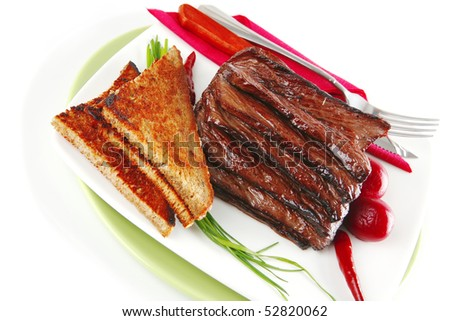 served cutted meat with bread and dishware