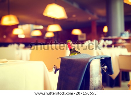 Served dinner table in a restaurant. Restaurant interior. Cozy restaurant table setting. Defocused background - stock photo