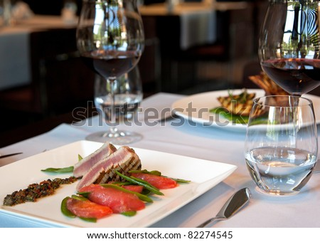 Served dinner with seafood and vine - stock photo
