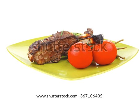 served entree: ribs on plate with hot peppers and capers on green - stock photo