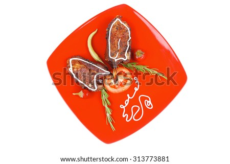 served entree: ribs on red plate with hot peppers and tomatoes - stock photo