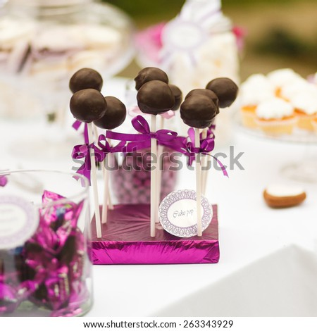 Served festive candy bar - chocolate candies lollipops - stock photo