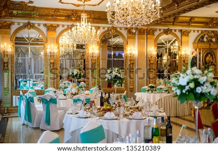 Served for banquet tables in a luxurious interior. - stock photo
