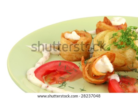 served fried potatoes with vegetables on green dish - stock photo