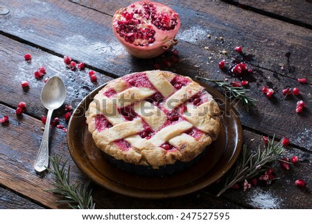 Served homemade tart cake stuffed pomegranate fruit jam,selective focus  - stock photo