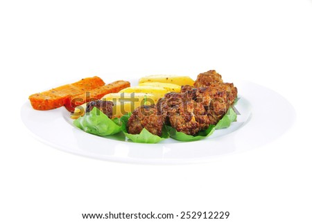 served meatballs on basil leaf with gold potatoes - stock photo