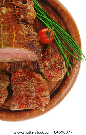 served peppered roast meat chops on wood - stock photo