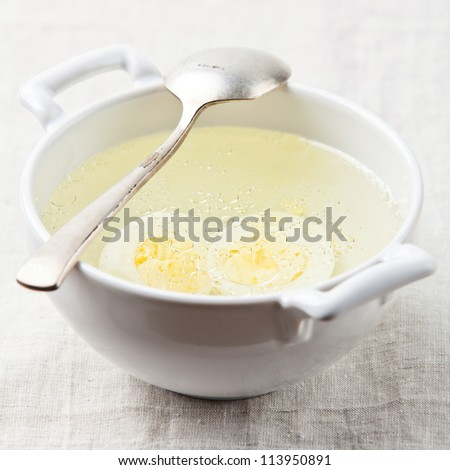 Served place setting with chicken broth