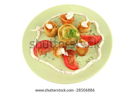 served potatoes with sauce on light dish over white - stock photo