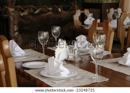 served restaurant table, wooden with white serviettes