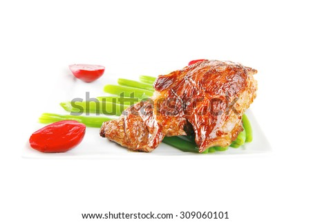served roasted beef meat with beans on white dish - stock photo