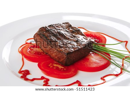 served roasted beef meat with tomato on white dish