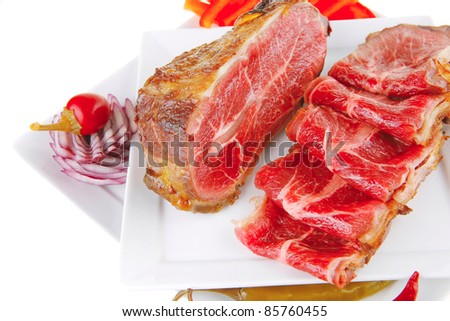 served roasted meat chunk with rolls on white platter