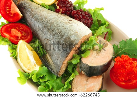 served salmon with caviar on plate over white - stock photo